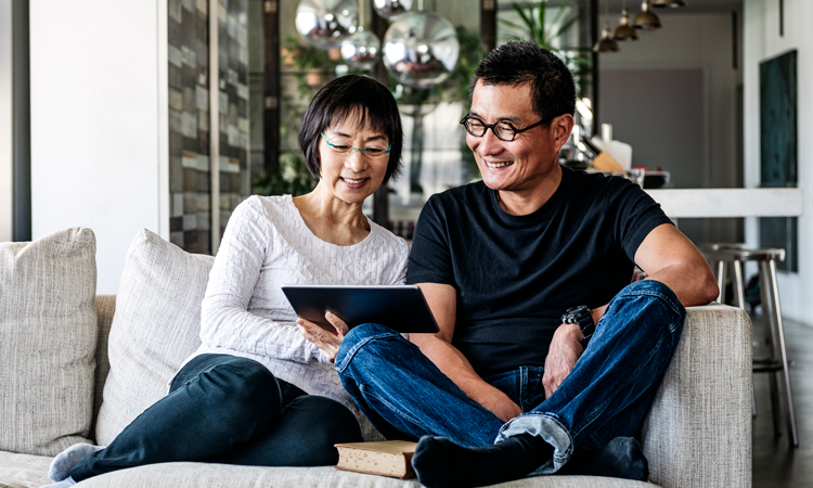 Two people looking at a mobile device